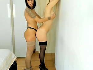 Two lesbian whores fucking with strapon