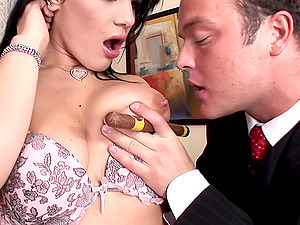 Black-haired floozy has huge tits her fella likes to play with