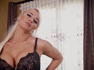Blonde doll Logan Long having fun with a stiff in her mouth