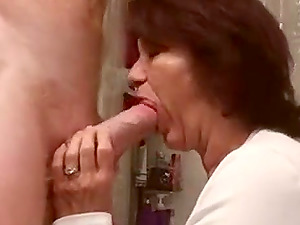 Hot milf taking big dick deep in her mouth