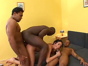 Sizzling brown-haired honey gets her raw vagina jammed with black dicks