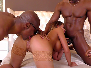 Buxom Brooklyn Chase is on her knees pleasuring several dicks