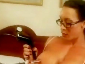 Sexy mature lady pumping her nipples.