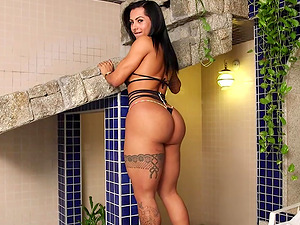 Shemale Isabelle Ferreira with big tits and big ass, enjoys playing with her cock