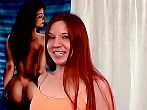 Redhead with small pierced tits strips completely nude and gives a sexy handjob