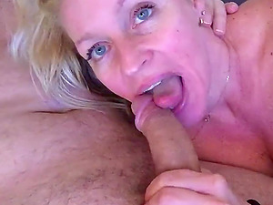 Horny cougar sucking mans dick in this closeup homemade video