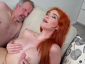 Redhead Gisha Forza rides a fat pecker while she moans loudly