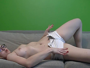Blond babe with a nice pussy and ass masturbates on couch