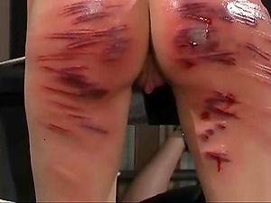 Kinky chick talks her naughty friend into hitting her with a stick