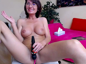 Sexy camgirl with big tits masturbating by vibrator in front of the webcam