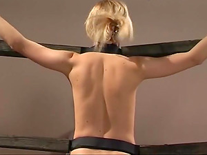 Slim chick gets tied up before a mistress starts hitting her hot body