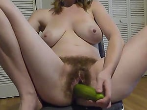 My hairy pussy devours a big cucumber