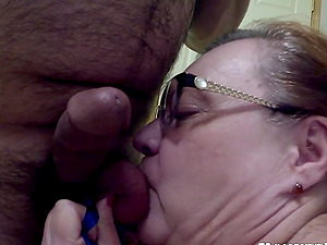 Hot mature wife with big tits sucks her man