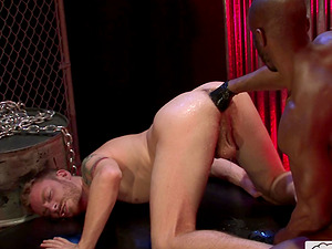 Balck gay guy fists his white male slave in the dungeon