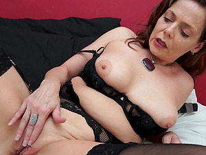 Good looking Gemma Gold enjoys drilling her cunt with a long dildo
