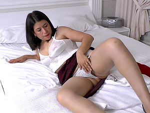 Anabella E. teases us with her hot body and uses her dildo
