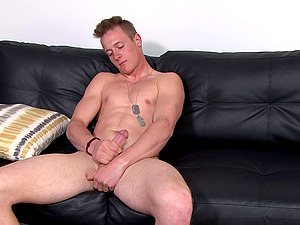 Blonde military gay guy masturbates with his dog tags on him
