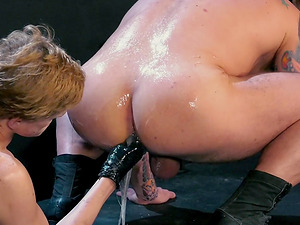 Messy anal fisting session with tattooed guys in a dungeon