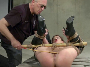 He tortures her with a vibrator while she has a buttplug inside her