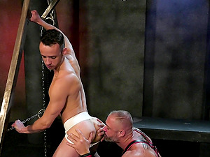 Hardcore gay blowjob and fisting session with horny dudes in a dungeon