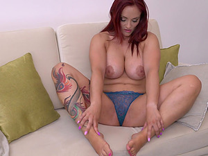 Tattooed buxom red head Mary Rider fingers her mature pussy