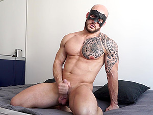 Jacked up gay dude David Boss puts on his mask and masturbates
