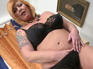 Mature tattooed buxom blonde MILF Alex strips at home