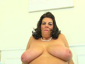 Mega sized boobs and a dildo deep inside the pussy of Lulu