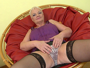 Short haired blonde mature granny Anna C. fingers her pussy
