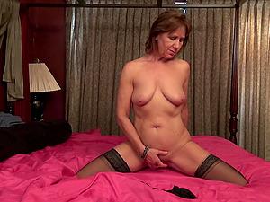 Skinny mature amateur redhead MILF Demi strips and masturbates
