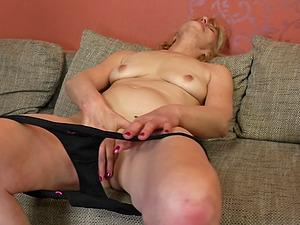 Blonde mature amateur granny Meriska B. strokes her shaved pussy