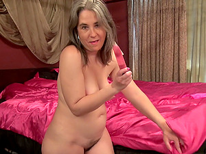 Blonde buxom mature amateur Olivia O. masturbates with a dildo