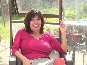 Busty brunette mature amateur British MILF Tara Holiday