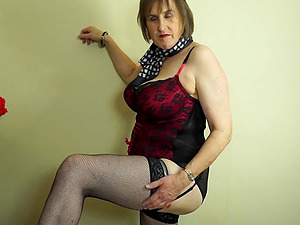Busty mature amateur British granny Allison masturbates in stockings