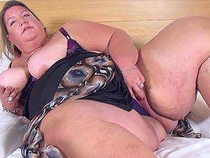 Buxom amateur mature BBW Sylvia D. licks her huge tits