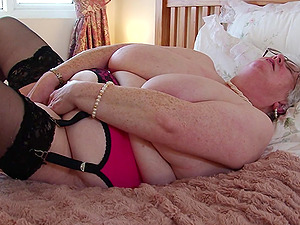 Mature amateur buxom British short haired granny Caroline V.
