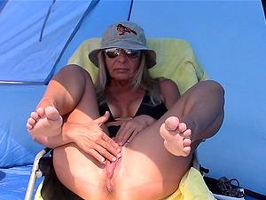 Horny Mature Masturbates Her Big Pussy On Beach