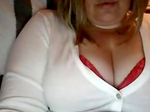 Chubby blonde plays with chubby tits on webcam