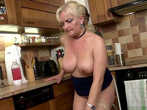 Mature buxom blonde amateur Milena V. strips in the kitchen