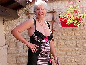 Short haired mature amateur granny Caroline strips in the garden