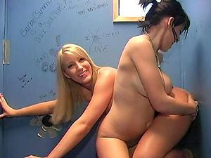 Naughty babes Barb Cummings and Gia Paloma share a glory hole cock