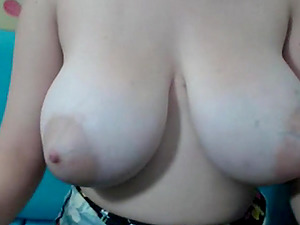 Brunette with enormous juggs teases and masturbates on livecam
