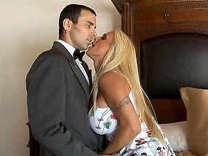 Big-boobed blonde mistress Holly Halston fucks beautiful butler Voodoo