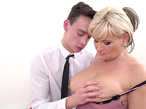 Mature blonde MILF Margaux M. picks up a younger guy on the street