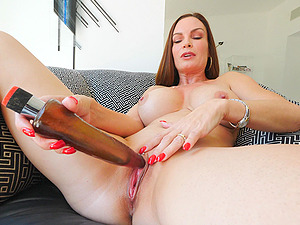 Playful MILF babe Diamond stuffs her pink pussy with a huge toy