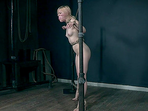 Pale elegant blonde slave Bambi Belle abused and tied up outdoors