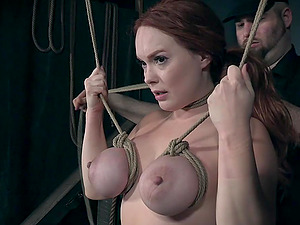Big fake tits and puffy nipples of Summer Hart abused in bondage