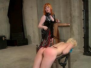 Redhead latex lesbian Mistress Irony abuses her slave girl Ava