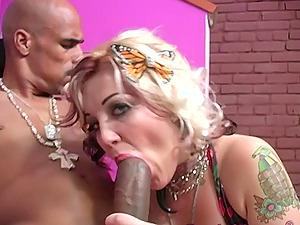 Tattooed blonde slut in high heels Candy Monroe rides a big black dick