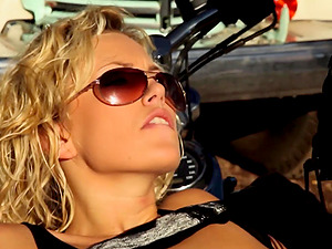Trendy biker babe Jazy Berlin bent over a motorcycle and pounded hard
